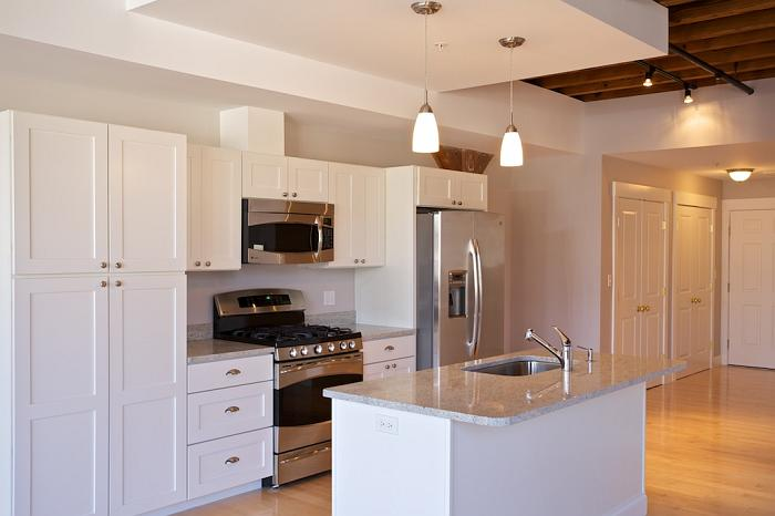 Shaker White Cabinets and Stainless Steel Accessories